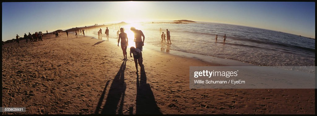 People Enjoying At Beach On Sunny Day : Foto stock