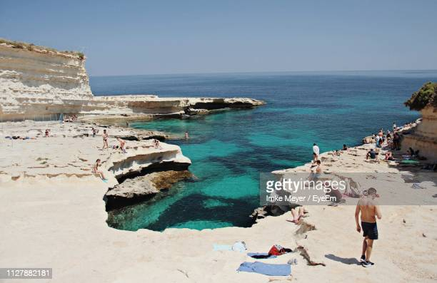 people enjoying at beach - malta stock pictures, royalty-free photos & images