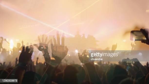 people enjoying at music concert - ポップコンサート ストックフォトと画像