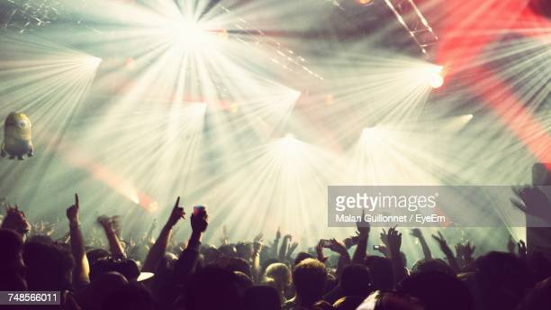 people enjoying at music concert - entertainment event stock pictures, royalty-free photos & images