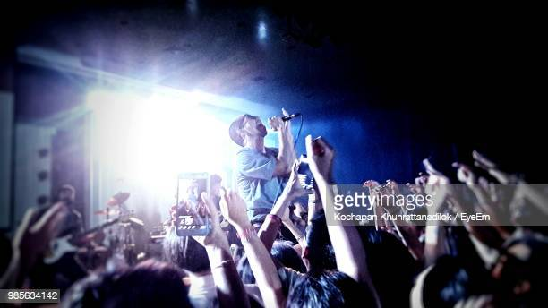 people enjoying at music concert - live event stock pictures, royalty-free photos & images