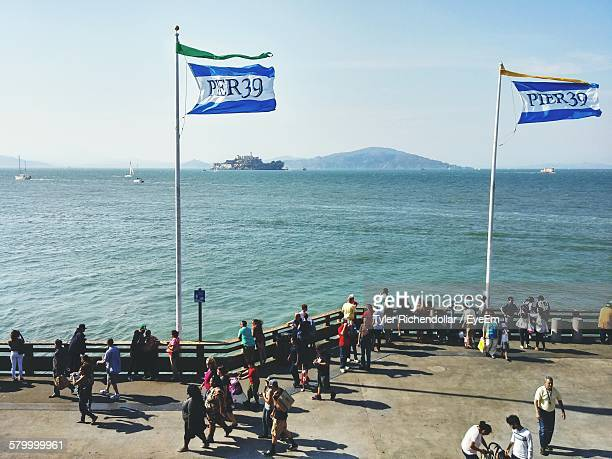 people enjoying at pier 39 by sea against sky - fishermans wharf stock pictures, royalty-free photos & images