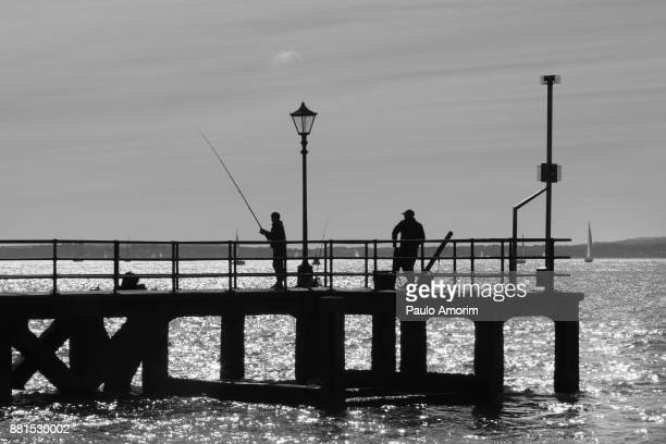 People enjoying at pier in Portsmouth Harbour,UK