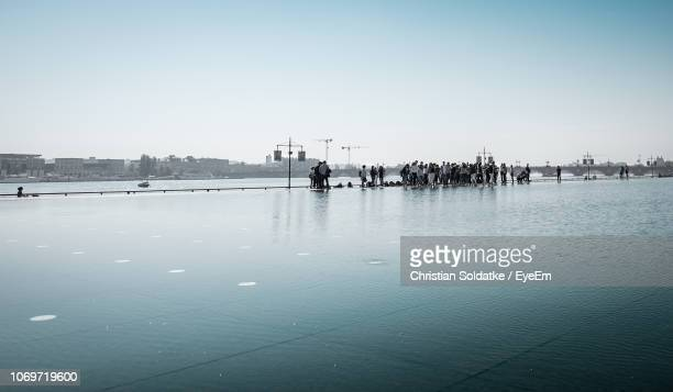people enjoying at sea against clear sky - christian soldatke stock pictures, royalty-free photos & images