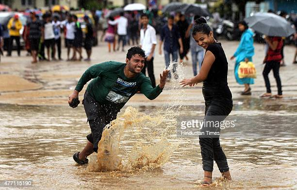 People enjoying at water logged after rain at Girgaon beach on June 14 2015 in Mumbai India Heavy rains caused major water logging in many areas...