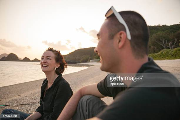 People enjoying beach at dusk, Okinawa