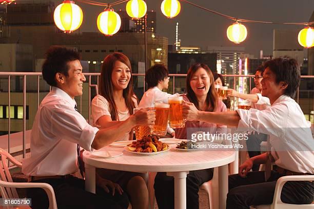 People Enjoying Beer and Snacks