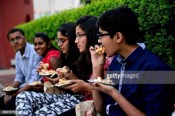 People enjoying burgers of Burger King on November 12 2014 in New Delhi India