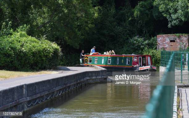 People enjoying canal boating on the River Avon on July 18 2019 in BradfordonAvon Wiltshire England Thousands of tourists from the UK and overseas...