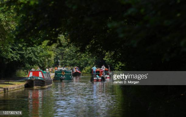 People enjoying canal boating on the River Avon on July 18, 2019 in Bradford-on-Avon, Wiltshire, England. Thousands of tourists from the UK and...