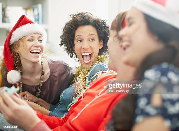 people enjoying christmas party - christmas party stock photos and pictures