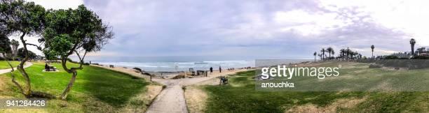 People enjoying Del Mar beach, California, USA
