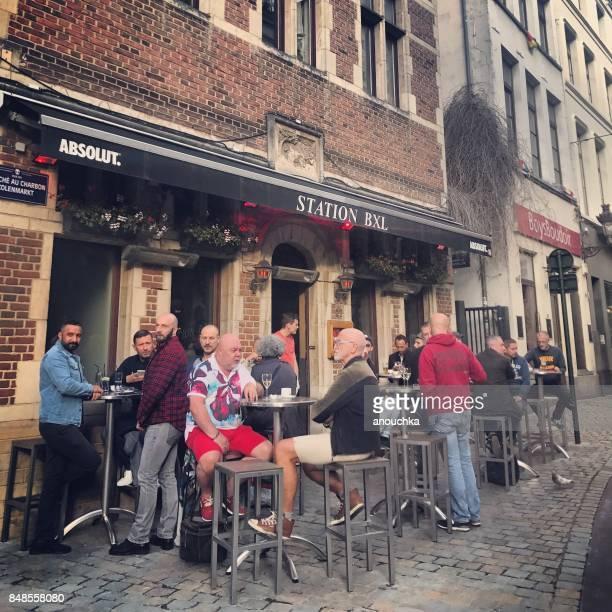 People enjoying drinks at the bar, Brussels, Belgium
