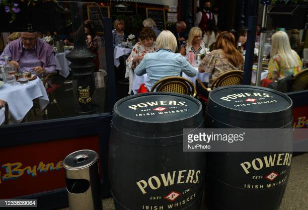 People enjoying food and drink at Davy Byrnes Pub, the Dublin 'moral pub' immortalised by James Joyce in Ulysses. On Monday, 05 July 2021, in Dublin,...