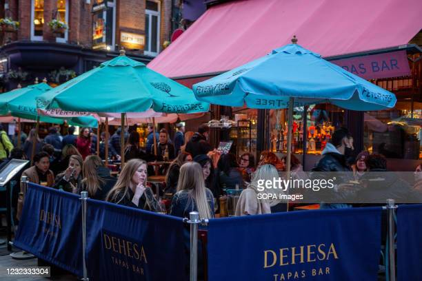 People enjoying food and drinks in Carnaby Street area. As the lockdown restrictions are eased from 12th April, people are able to eat and drink...