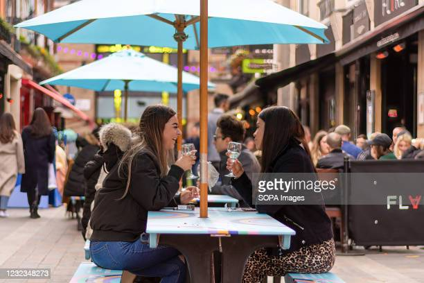 People enjoying food and drinks in Carnaby Street area. People in England flock back to Pubs and Restaurants as lockdown restrictions were eased on...