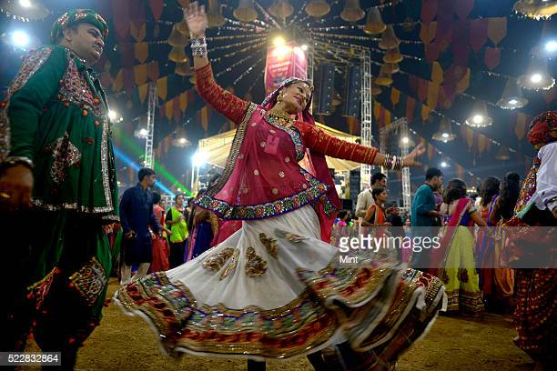 People enjoying Garba dance in colorful traditional Gujrati dresses on the occasion of Navratri on October 20 2015 in Baroda India