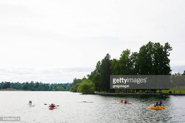 People enjoying Green Lake in Seattle, WA