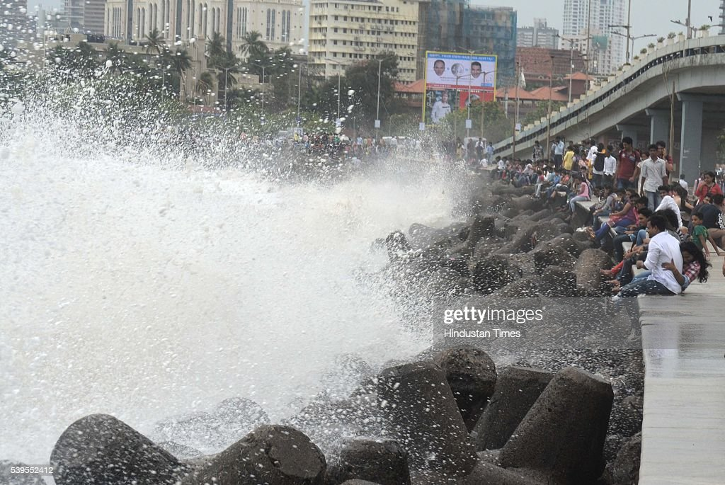 Superb People Enjoying High Tide At Marine Drive During Premonsoon Showers On June  11 2016 In Mumbai