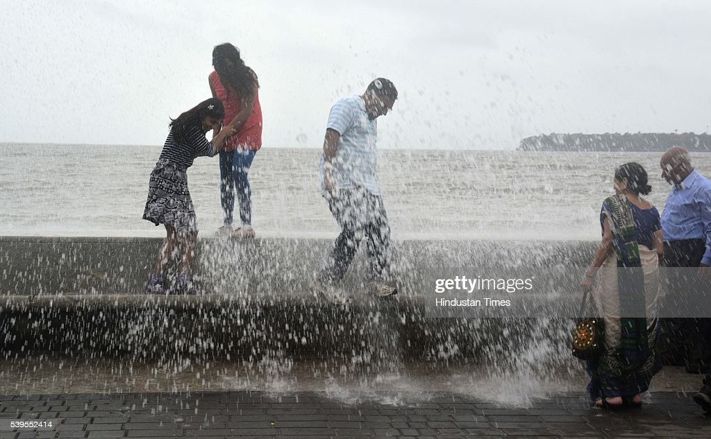 People Enjoying High Tide At Marine Drive During Premonsoon Showers On June  11 2016 In Mumbai
