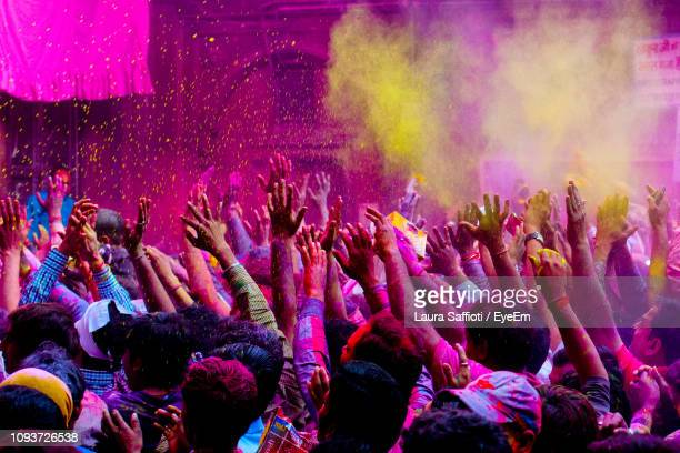 people enjoying holi outdoors - cultures stock pictures, royalty-free photos & images