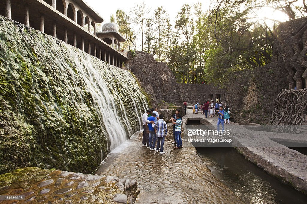 People enjoying in a waterfall at Rock garden by Nek Chand Saini Rock Garden of Chandigarh India