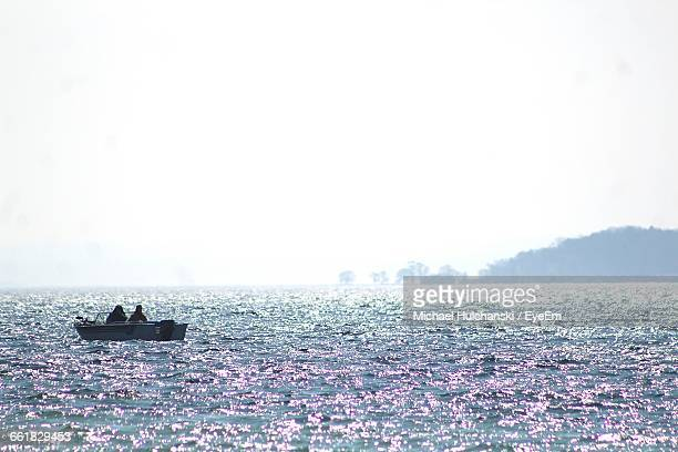 people enjoying in cayuga lake against clear sky on sunny day - finger lakes stock pictures, royalty-free photos & images