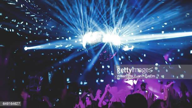 People Enjoying In Nightclub