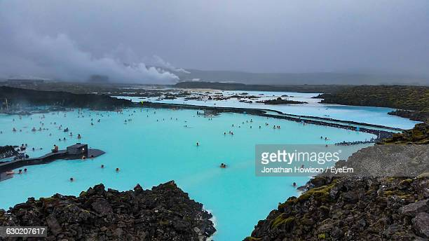 people enjoying in spa at blue lagoon - blue lagoon iceland stock pictures, royalty-free photos & images