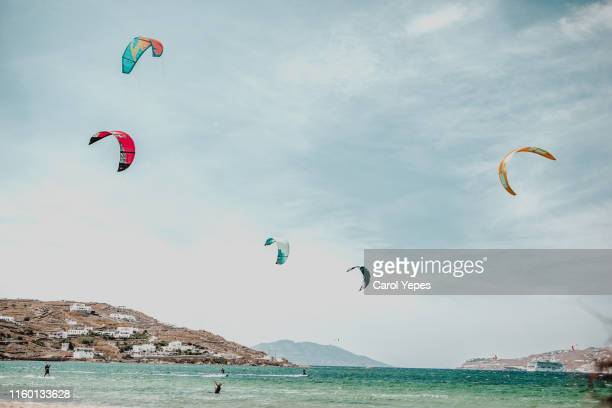 people enjoying kite surf on the beach - naxos stockfoto's en -beelden