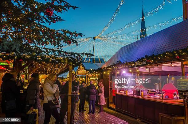 People Enjoying Lubeck Christmas Market at Twilight