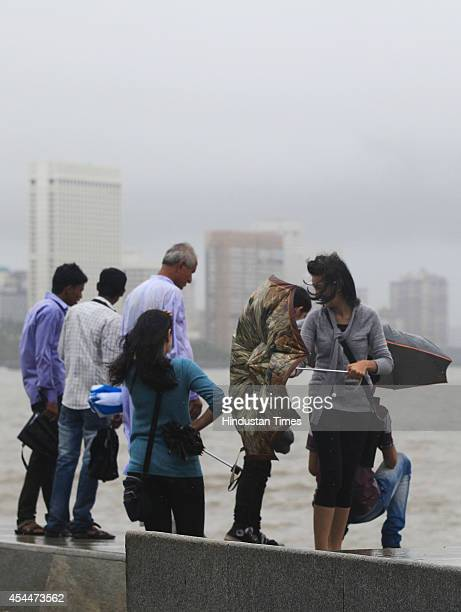 People enjoying Marine Drive on rainy evening on September 1 2014 in Mumbai India With heavy rains lashing the city for second consecutive day the...
