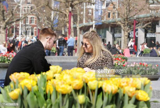 people enjoying nice weather in amsterdam - museumplein stock pictures, royalty-free photos & images