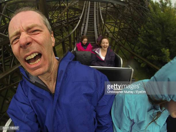 People enjoying on rollercoaster