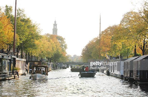 People Enjoying on the boats in Amsterdam