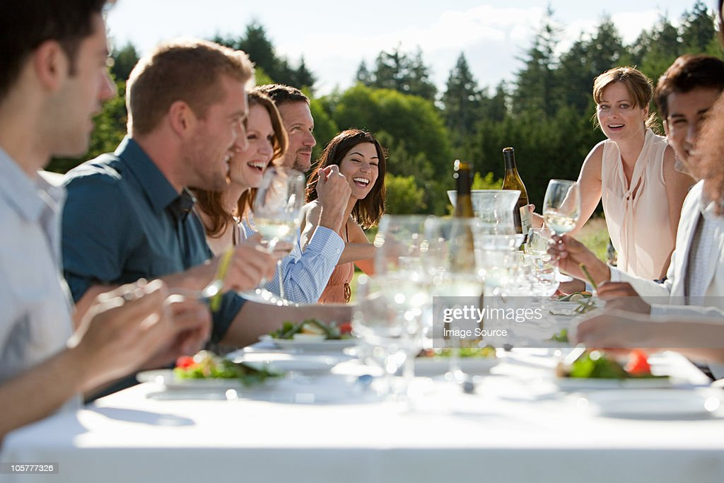 People enjoying outdoor dinner party : Stock Photo