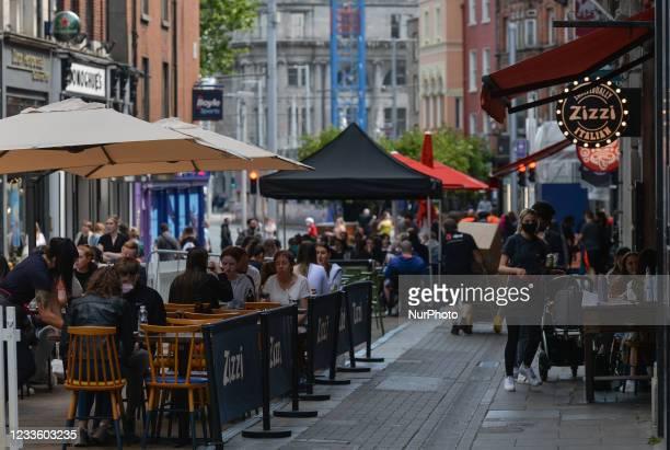 People enjoying outdoor dinning in Dublin center. On Tuesday, 22 June 2021, in Dublin, Ireland.