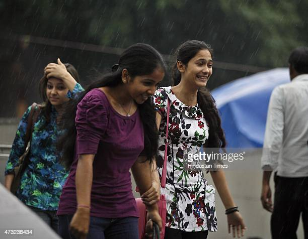 People enjoying pleasant weather during sudden rains as they got respite from scorching weather at India Gate on May 13 2015 in New Delhi India...