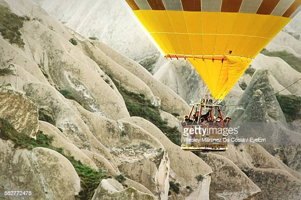 People Enjoying Ride Hot Air Balloon Above Rocky Mountains