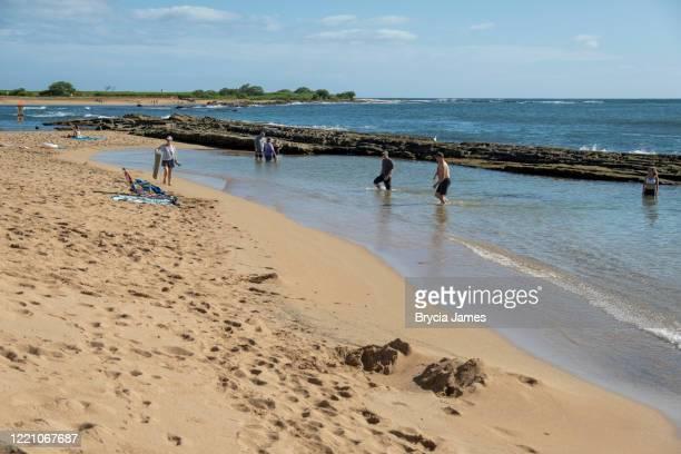 people enjoying salt pond park beach - brycia james stock pictures, royalty-free photos & images