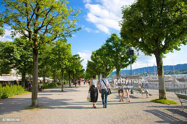 People enjoying seaside view, Lake Zurich