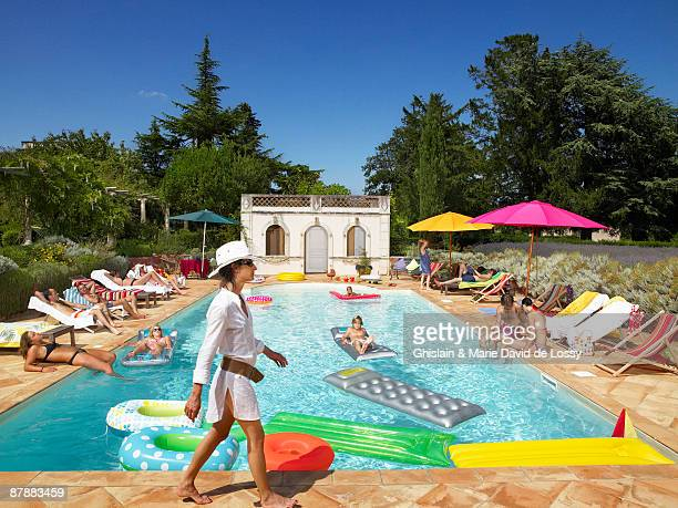 people enjoying summer around the pool - girls sunbathing stock photos and pictures