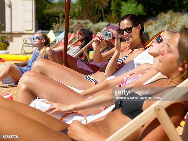 People enjoying summer around the pool
