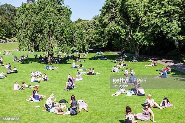 People enjoying summer; Princes St Gardens, Edinburgh, Scotland