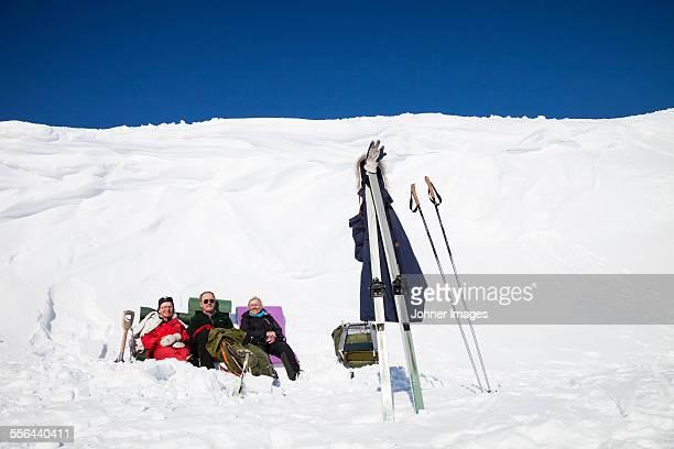 People enjoying sun at winter