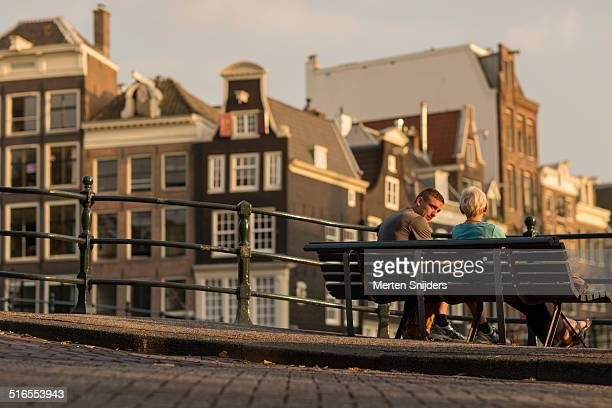 people enjoying sunset along prinsengracht - merten snijders stock pictures, royalty-free photos & images