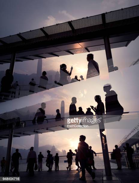 People enjoying sunset at Victoria Harbour in Hong Kong