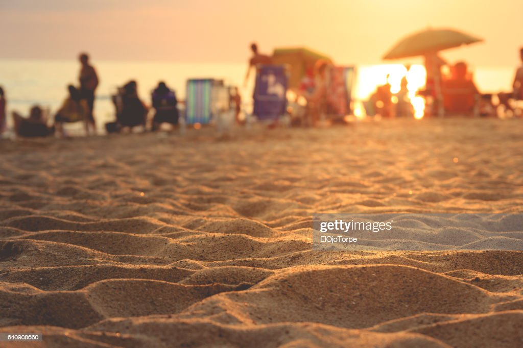 People enjoying the beach at sunset, Piriápolis, Uruguay : Foto de stock