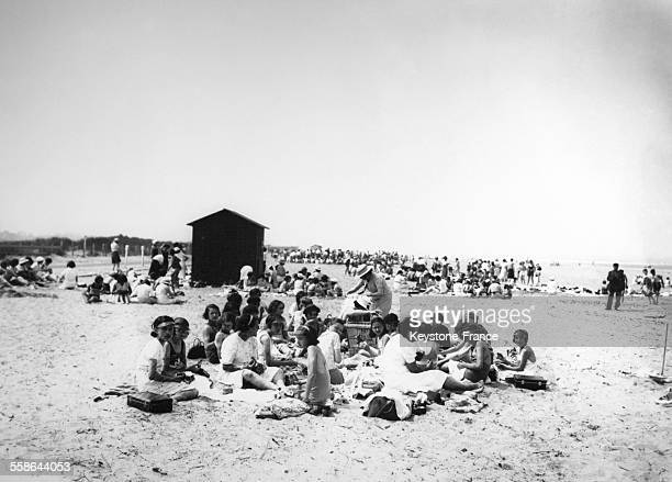 People enjoying the beach of Deauville during summer holiday on July 22 1937 in Deauville France