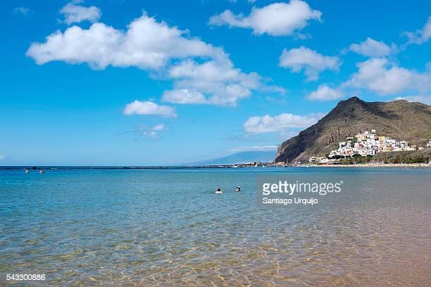 People enjoying the beach of Teresitas